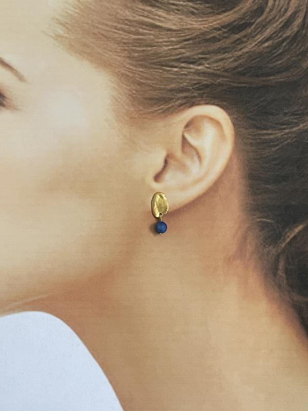 Lapis and gold earrings modelled
