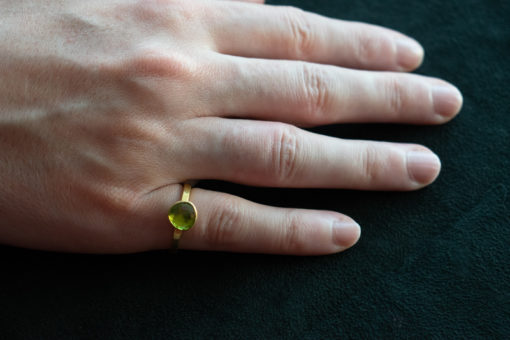 Bright green faceted peridot ring