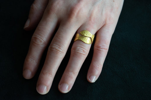 22ct gold carved fish ring on finger