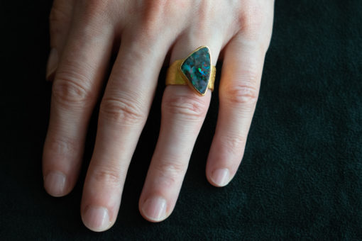 Triangle boulder opal ring