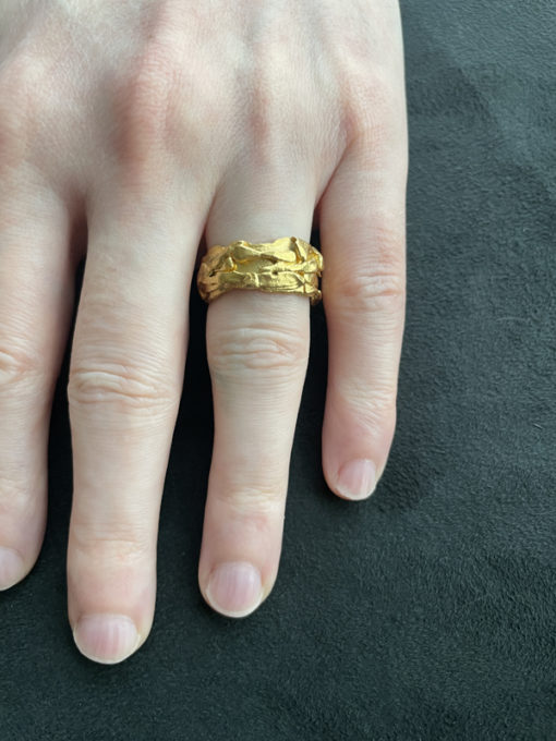 scrappy ring on finger