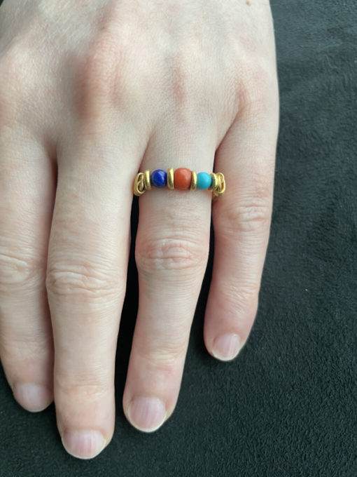 Cleopatra ring on finger